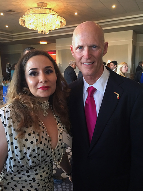 Evelina Libhen with the Governor of Florida, Rick Scott